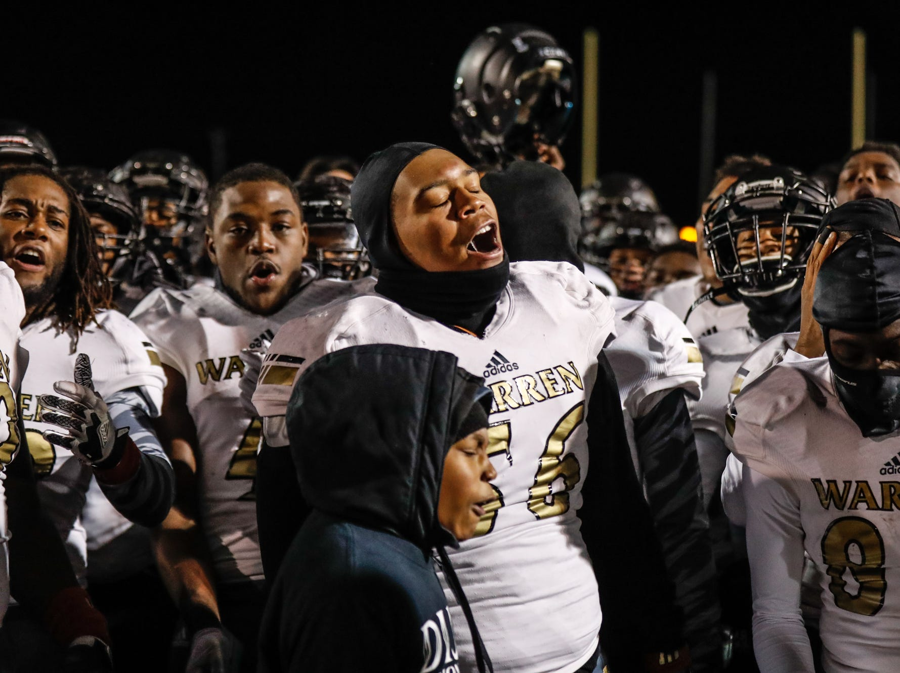 The Warren Central High School Warriors varsity football team celebrates a regional finals win over the North Central High School Panthers at North Central High School on Friday, Nov. 9, 2018.
