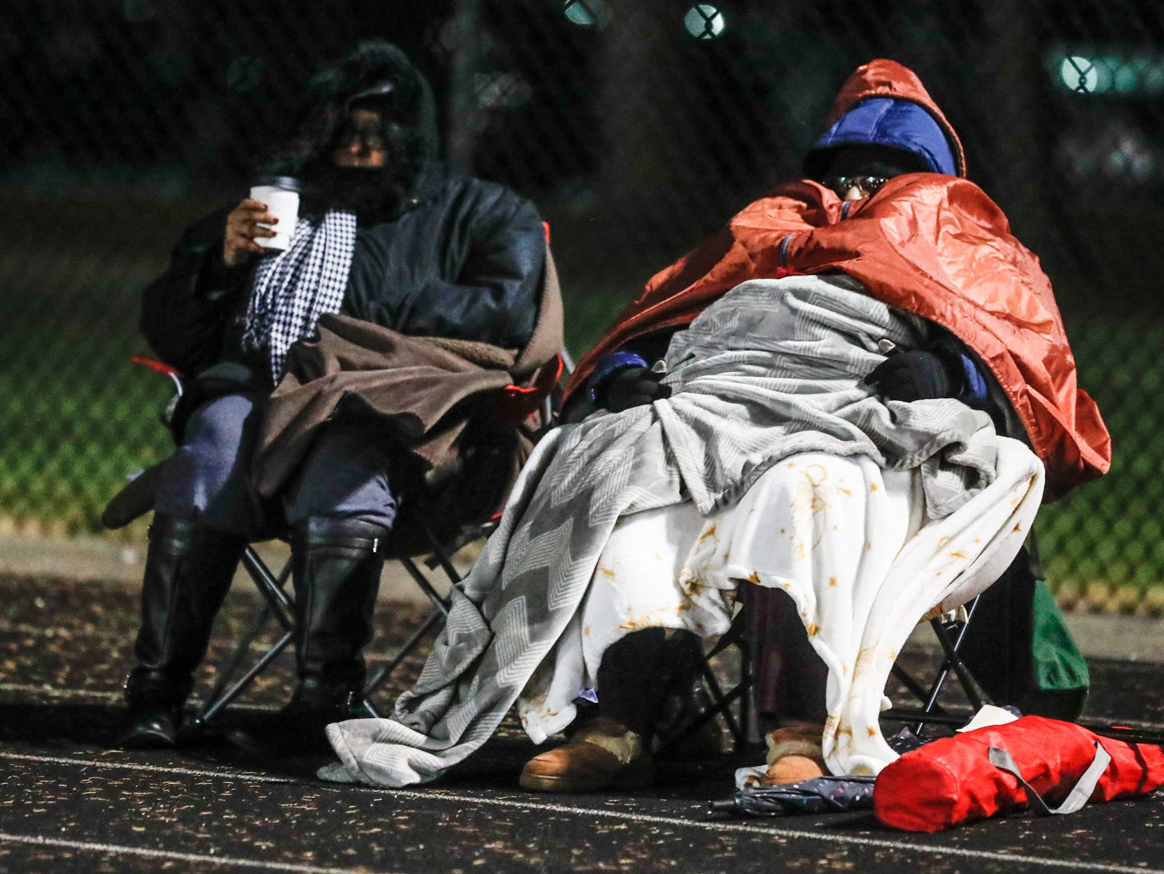 Fans bundle up to keep warm during a regional finals game between the North Central High School Panthers and the Warren Central High School Warriors at North Central High School on Friday, Nov. 9, 2018.
