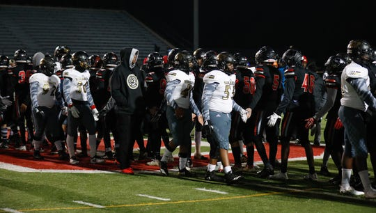The Warren Central High School Warriors shake hands with North Central High School players after defeating them in a regional finals game at North Central High School on Friday, Nov. 9, 2018.