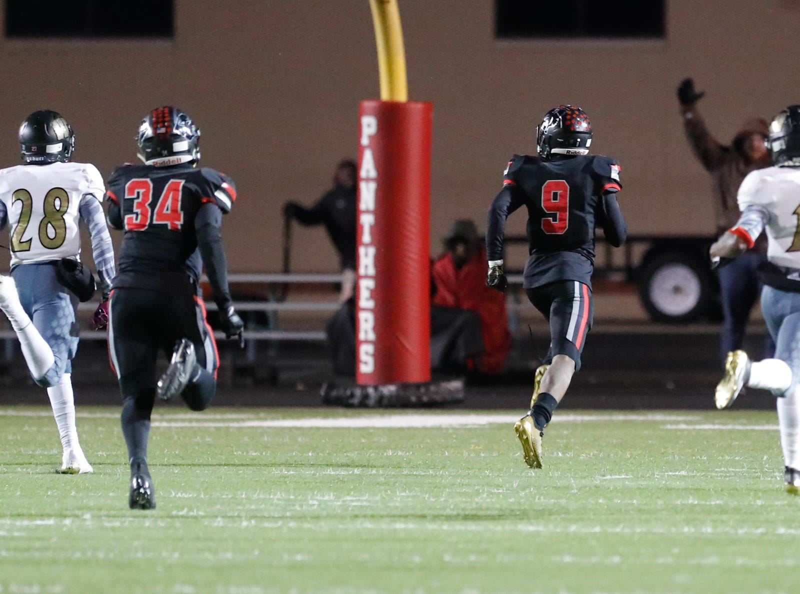 North Central High School Panthers Tre'von Elliott (9), outruns the Warren Central High School Warriors for an 85 yard touchdown, during a regional finals game at North Central High School on Friday, Nov. 9, 2018.