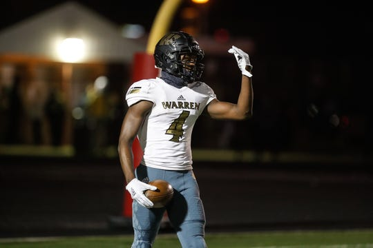 The Warren Central High School Warriors wide receiver David Bell (4), celebrates a touchdown during a regional finals game against the North Central High School Panthers at North Central High School on Friday, Nov. 9, 2018.