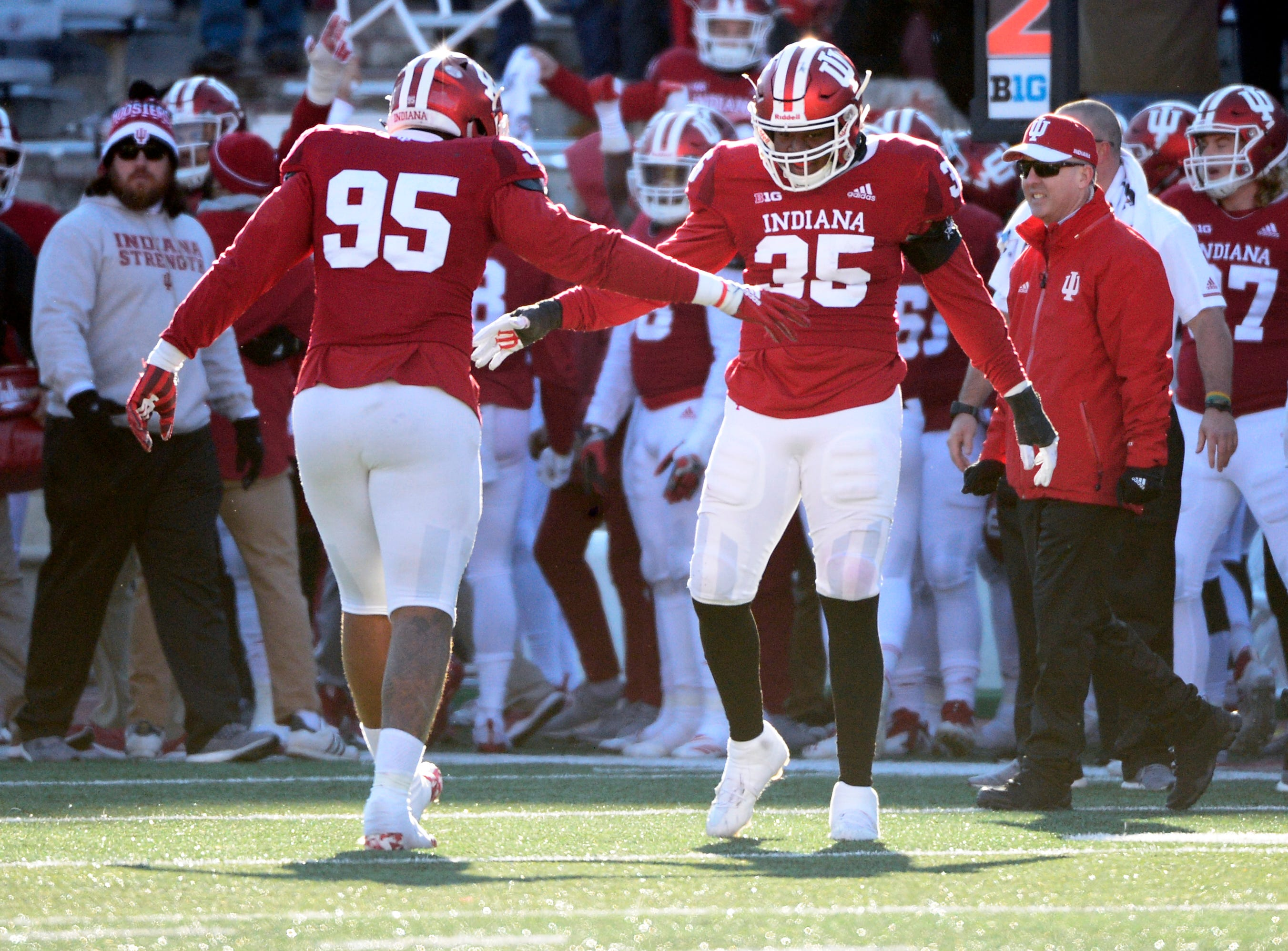 The Indiana Hoosiers celebrate after a game winning takeaway during the game against Maryland at Memorial Stadium in Bloomington, Ind., on Satuday, Nov. 10, 2018.