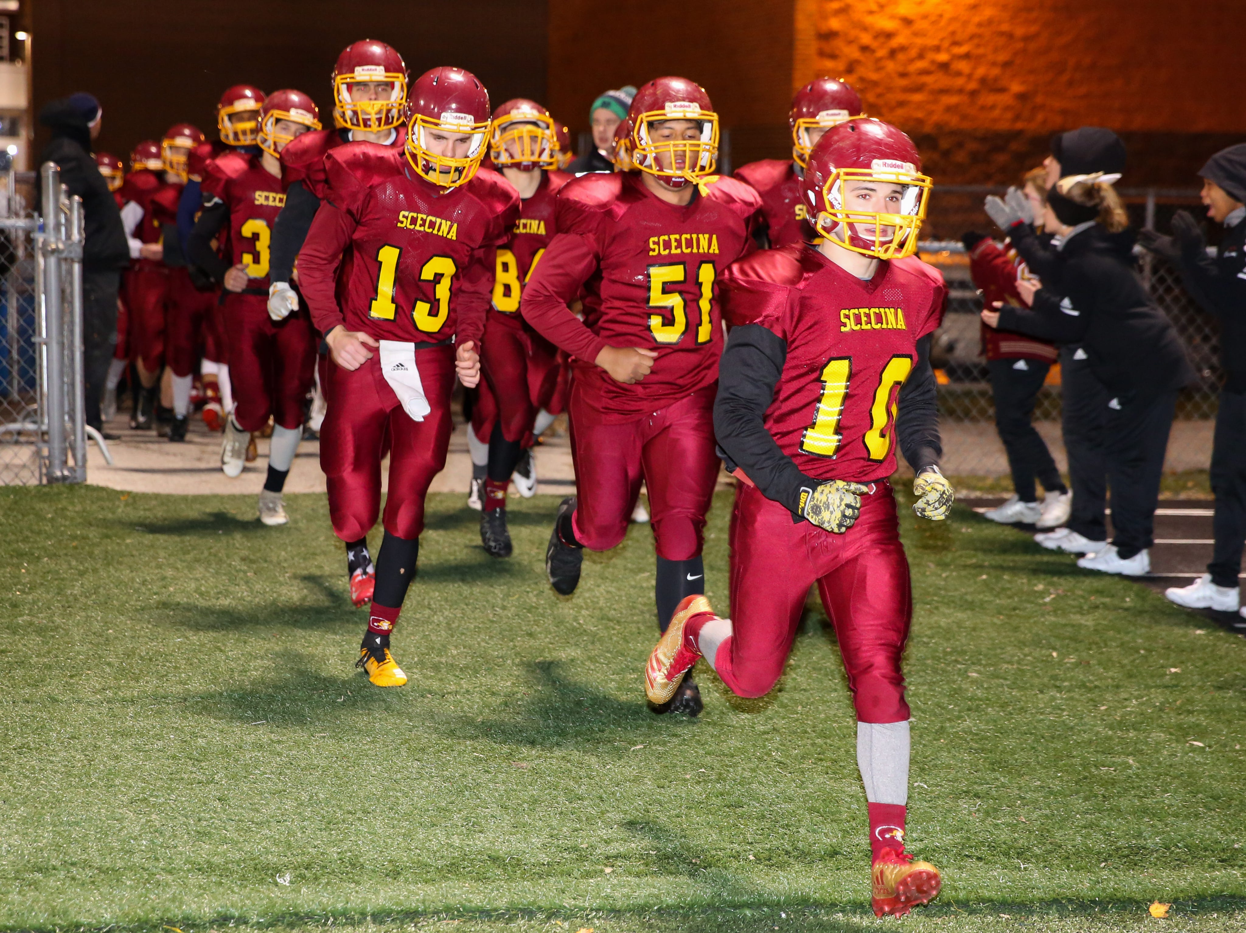 The Crusaders take the field for the start of Indianapolis Scecina vs Western Boone High School varsity football in the Class 2A Regional Championship held at Roncalli High School, Friday, November 9, 2018.