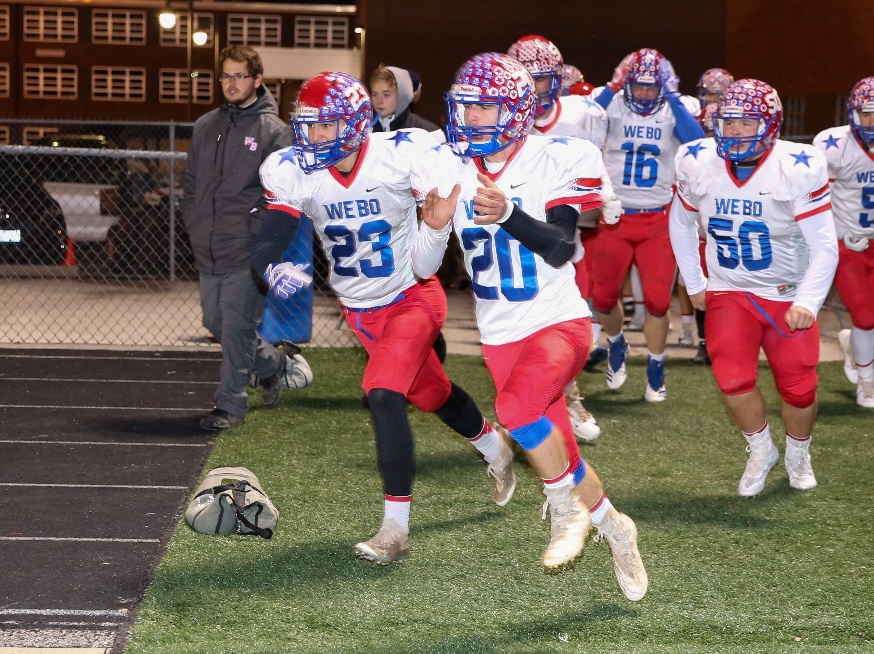 The Stars take the field for the start of Indianapolis Scecina vs Western Boone High School varsity football in the Class 2A Regional Championship held at Roncalli High School, Friday, November 9, 2018.