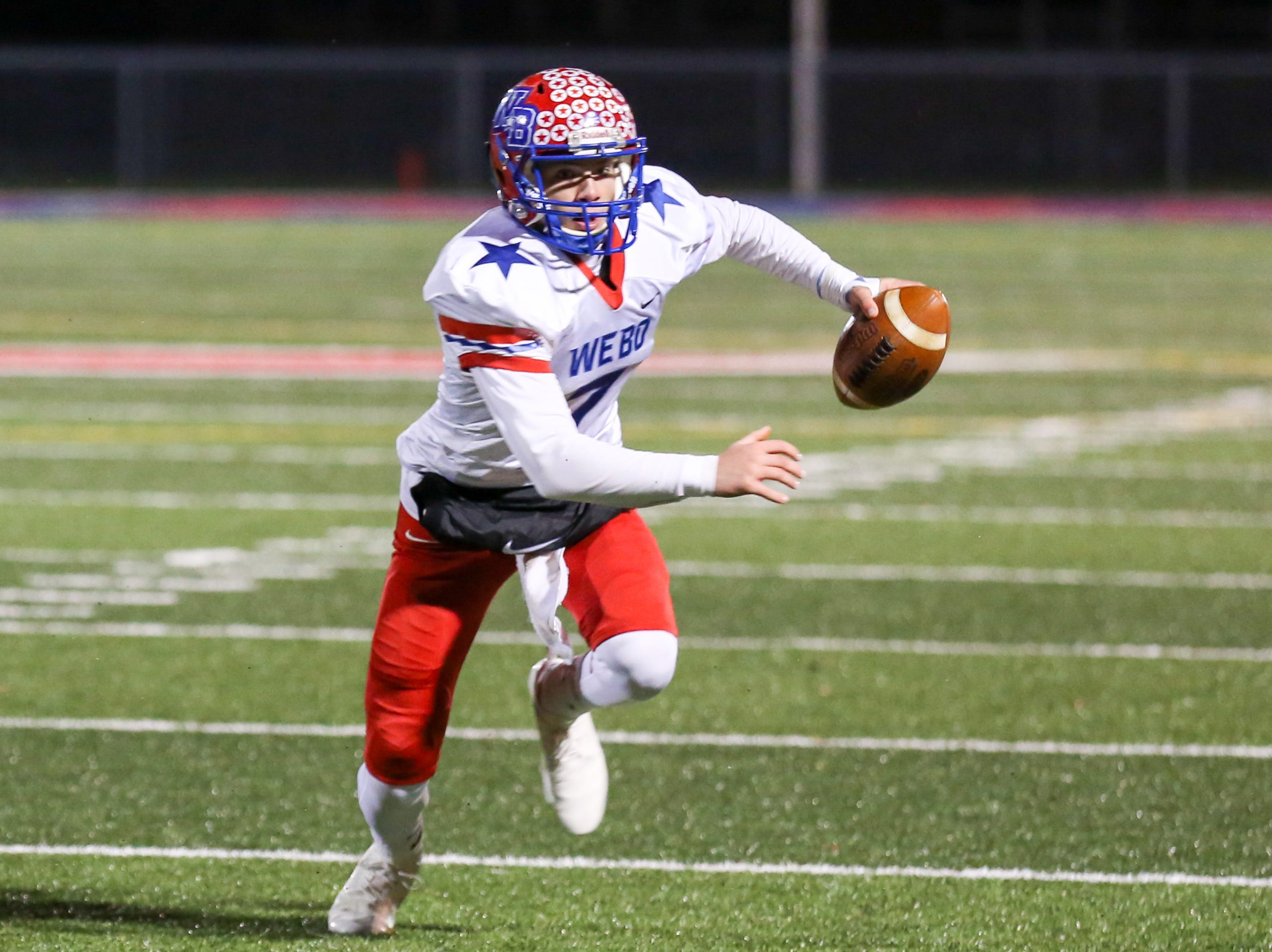 Western Boone's Spencer Wright (7) rolls out of the pocket and makes a run during the first half of Indianapolis Scecina vs Western Boone High School varsity football in the Class 2A Regional Championship held at Roncalli High School, Friday, November 9, 2018.