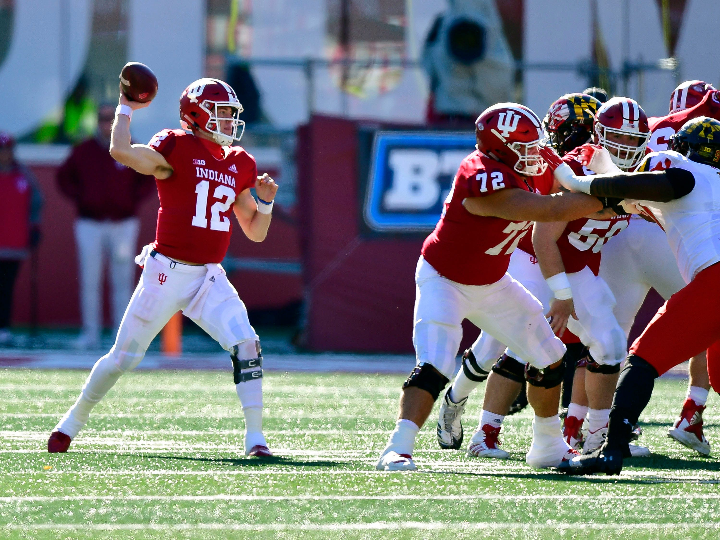 Indiana Hoosiers quarterback Peyton Ramsey (12) throws a pass during the fist half of the the game against the Maryland Terrapins at Memorial Stadium .
