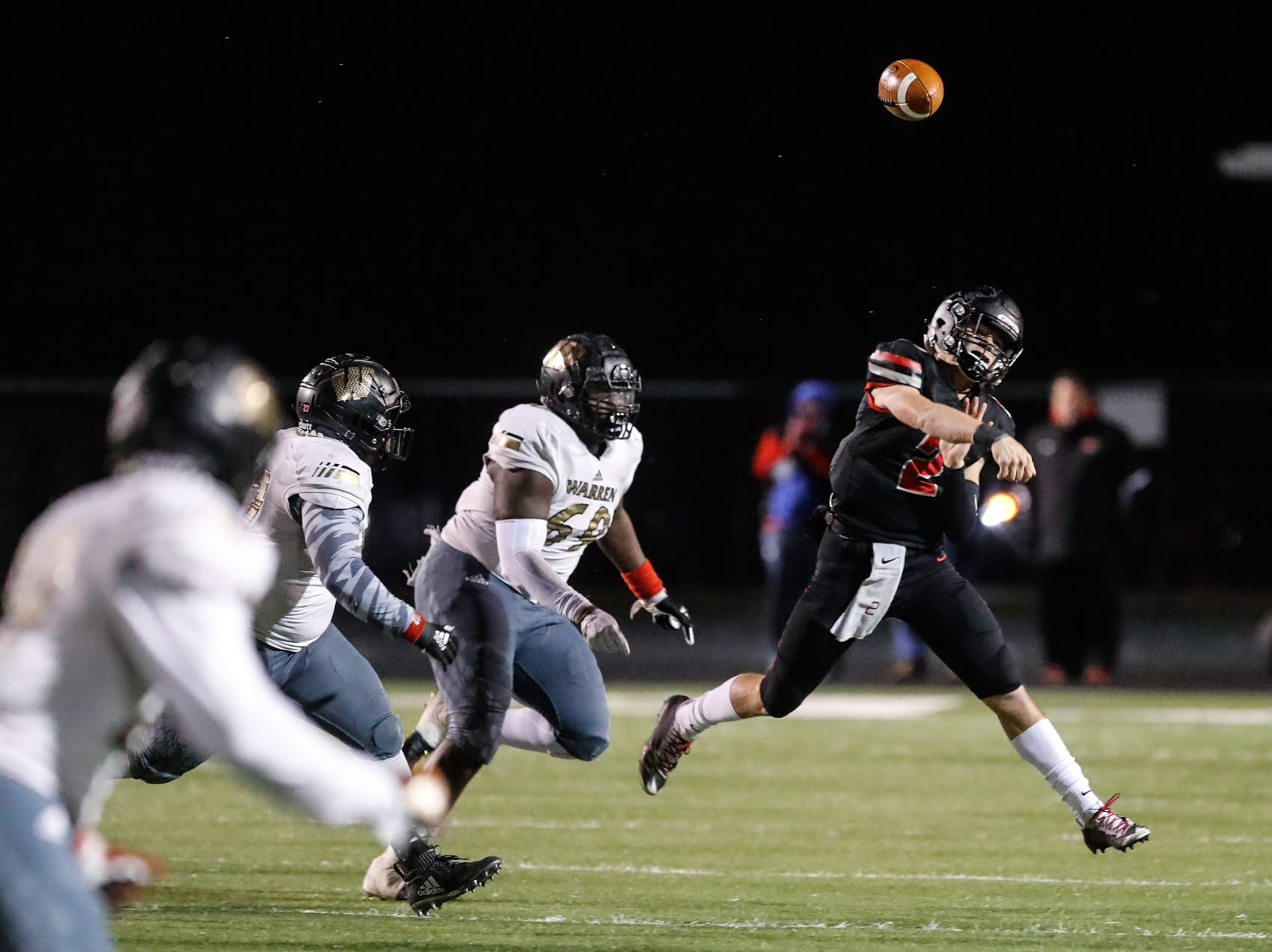 North Central High School Panthers QB Liam Thompson (2), throws a complete pass on the run during a regional finals game against the Warren Central High School Warriors at North Central High School on Friday, Nov. 9, 2018.