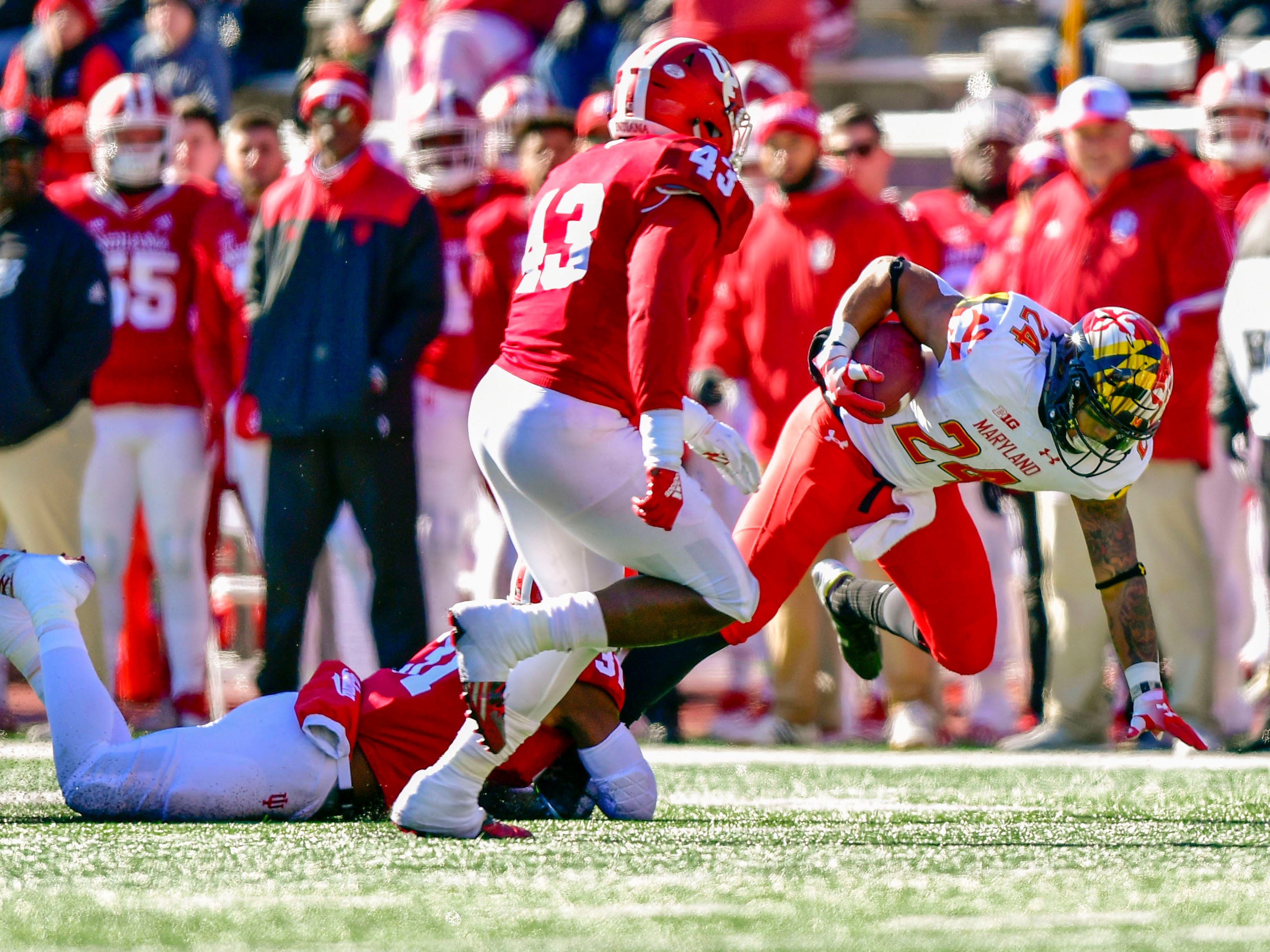 Maryland Terrapins running back Ty Johnson (24) is tackled by Indiana Hoosiers defensive back Bryant Fitzgerald (31) during the fist half of the the game at Memorial Stadium.