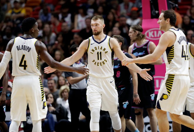 Indiana Pacers forward Domantas Sabonis (11) celebrates with guard Victor Oladipo (4) and forward Bojan Bogdanovic (44) after drawing a foul during the second half of the team's NBA basketball game against the Miami Heat, Friday, Nov. 9, 2018, in Miami. The Pacers won 110-102.