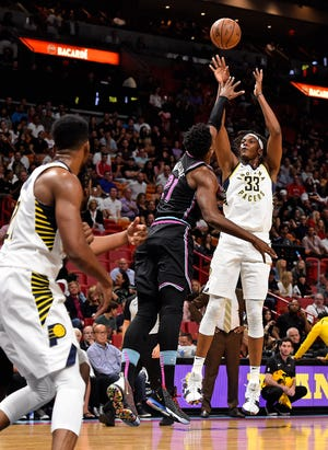Pacers center Myles Turner (33) shoots the ball over Miami Heat center Hassan Whiteside (21) during the first half at American Airlines Arena.