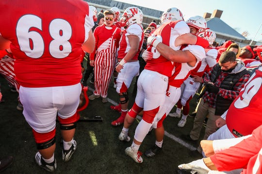 The Wabash College Little Giants and fans celebrate after winning the 125th Monon Bell Classic at Little Giant Stadium in Crawfordsville, Ind., Saturday, Nov. 10, 2018. Wabash won, 24-17.