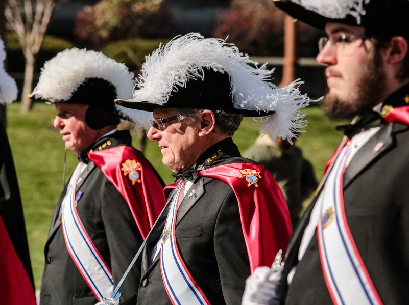 Knights of Columbus members march down Pennsylvania during the Veterans Day Parade.