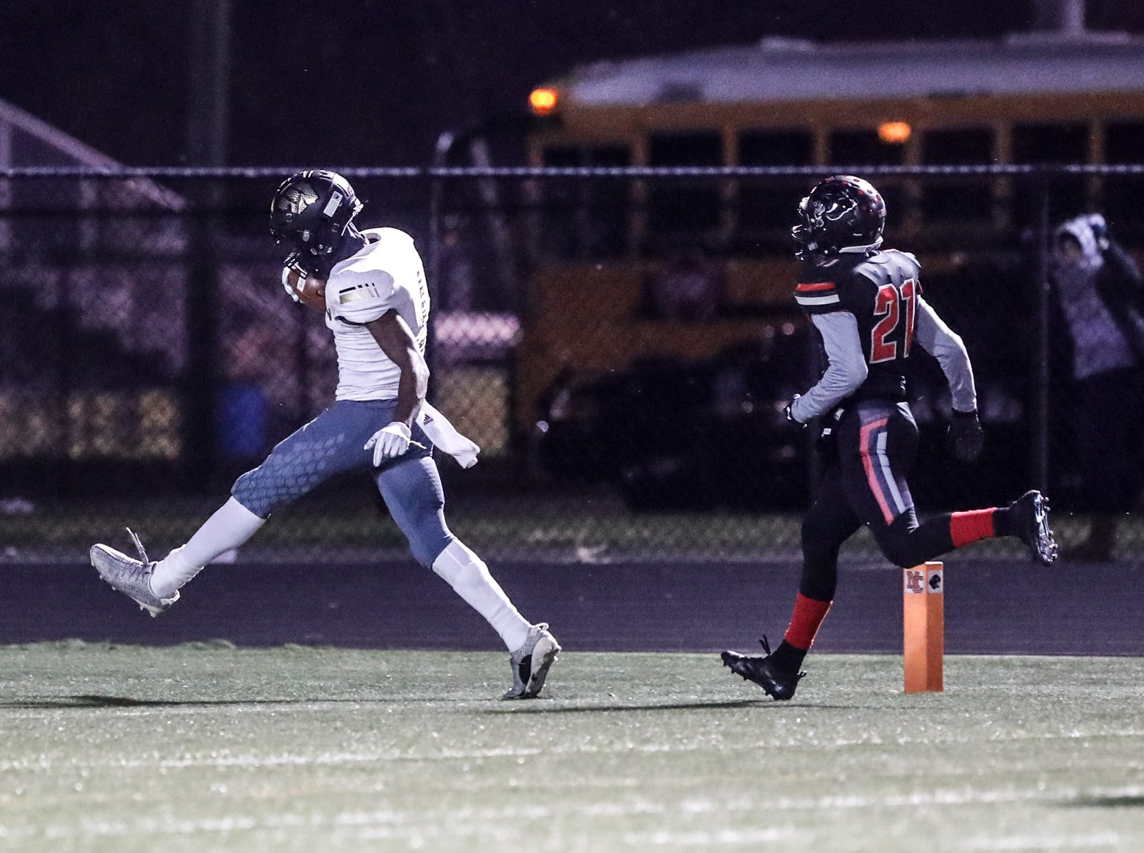 Warren Central High School Warrior's wide receiver David Bell (4), outruns North Central High School Panther's cornerback Theran Johnson (21), for an 80 yard touchdown during a regional finals game at North Central High School on Friday, Nov. 9, 2018.