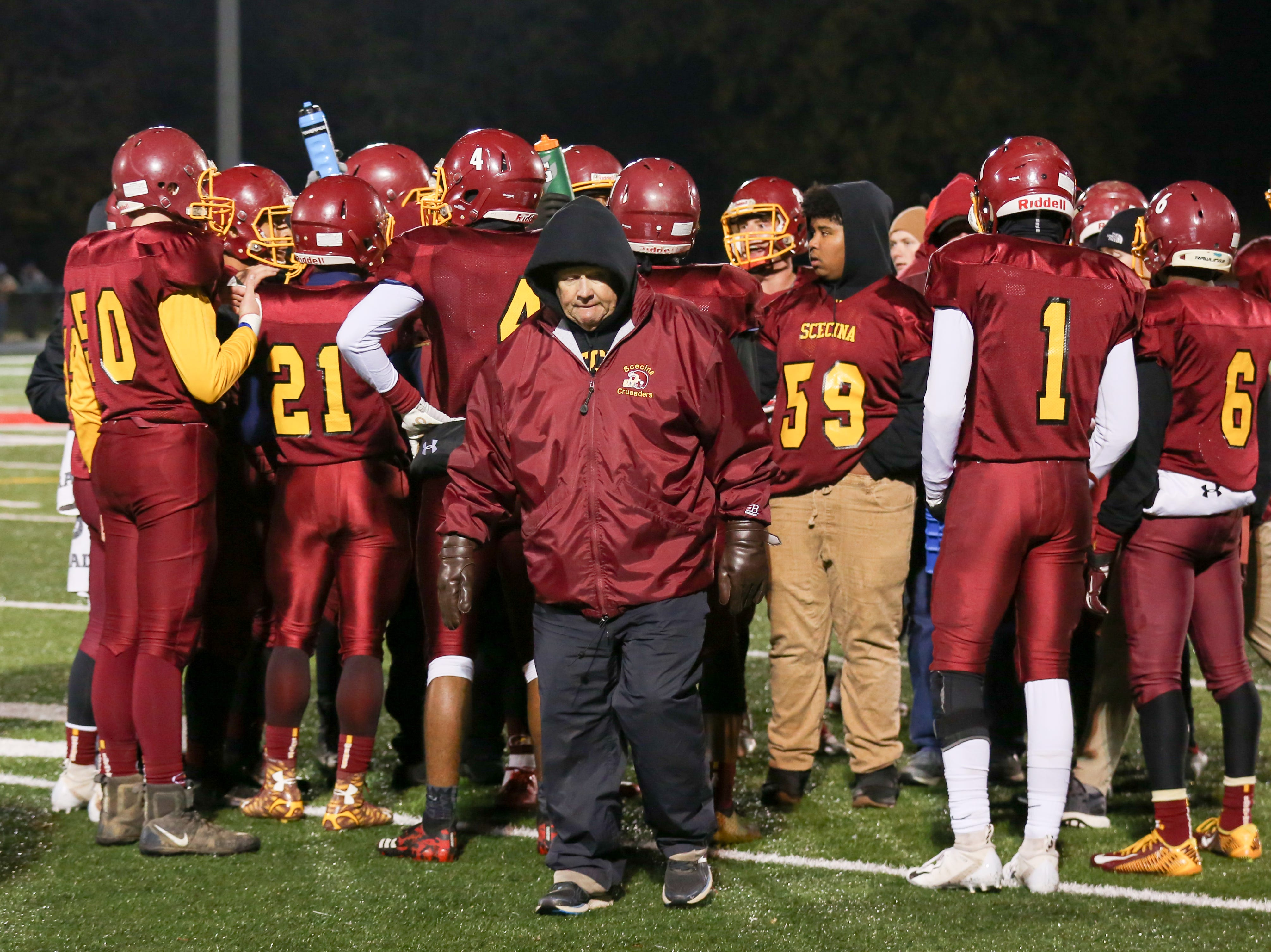 Scecina Coach Ott Hurrle gives instructions to his team during a time out during the first half of Indianapolis Scecina vs Western Boone High School varsity football in the Class 2A Regional Championship held at Roncalli High School, Friday, November 9, 2018.