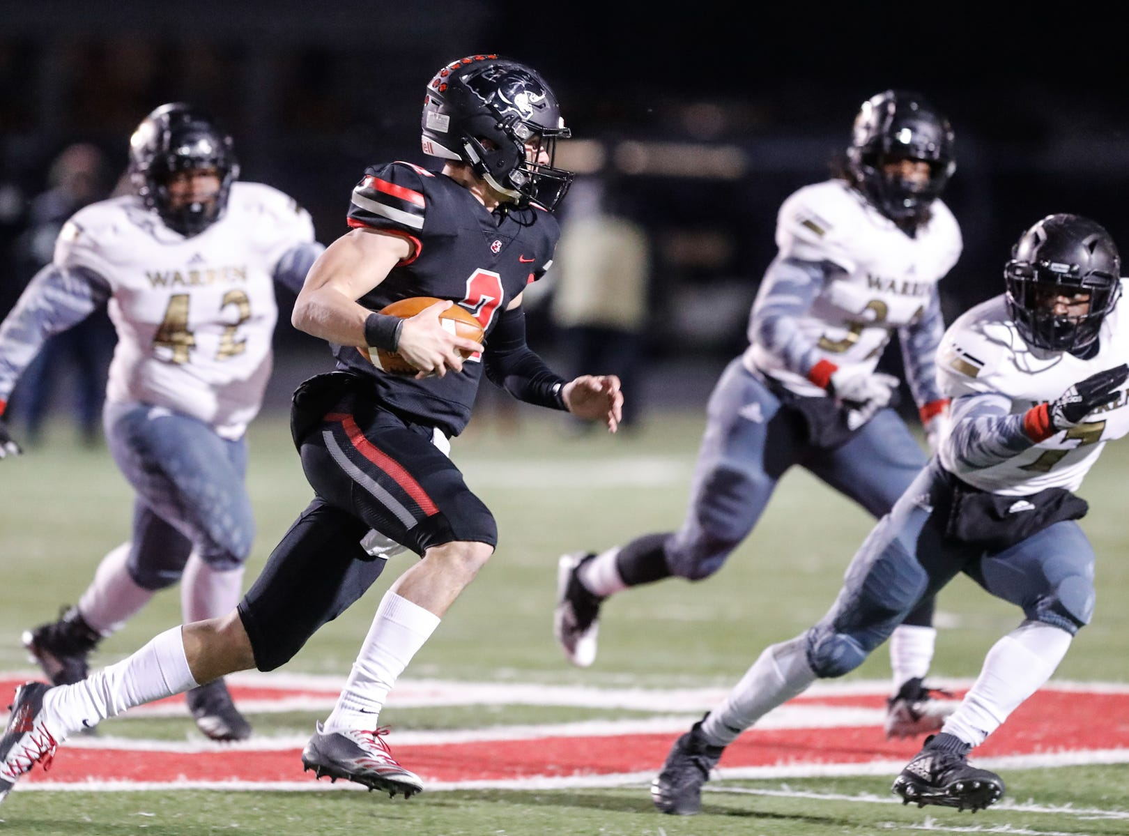 The North Central High School Panther's Liam Thompson (2), runs for the end zone during a regional finals game against the Warren Central High School Warriors at North Central High School on Friday, Nov. 9, 2018.