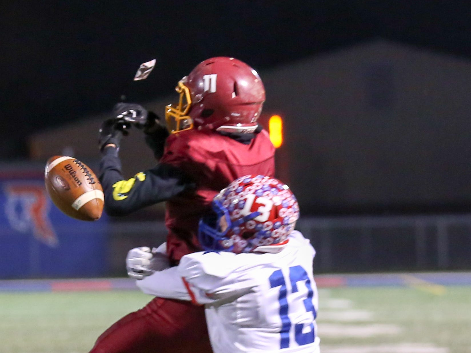 Scecina's Jaidon Barnes with coverage by Western Boone's Logan Benson (13) cannot hold on to the ball on this pass attempt during the first half of Indianapolis Scecina vs Western Boone High School varsity football in the Class 2A Regional Championship held at Roncalli High School, Friday, November 9, 2018.