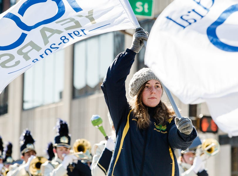 A woman waves a flag during the Veterans Day Parade.