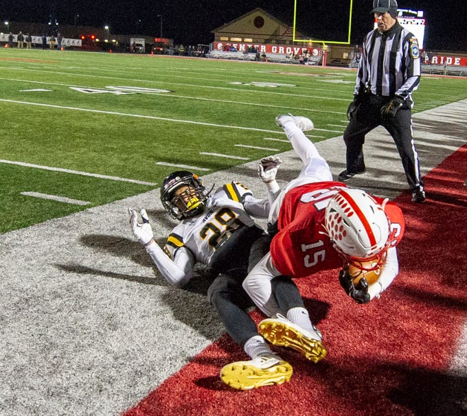 Avon High School senior Kamryn Molton (28) knocks Center Grove High School sophomore Trenton Veith (15) out-of-bounds to stop the play during the first half of action. Center Grove High School hosted Avon High School in an IHSAA Class 6A Regional Championship varsity football game, Friday, Nov. 9, 2018.