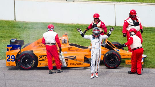 Fernando Alonso acknowledges the crowd's applause after climbing from his car at the Indianapolis 500 on May 28, 2017.