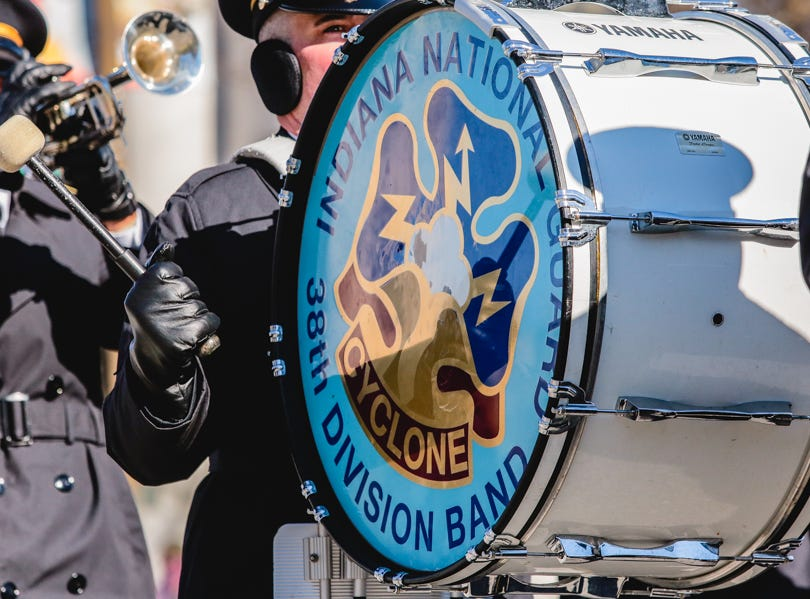 A drum is played during the Veterans Day Parade.