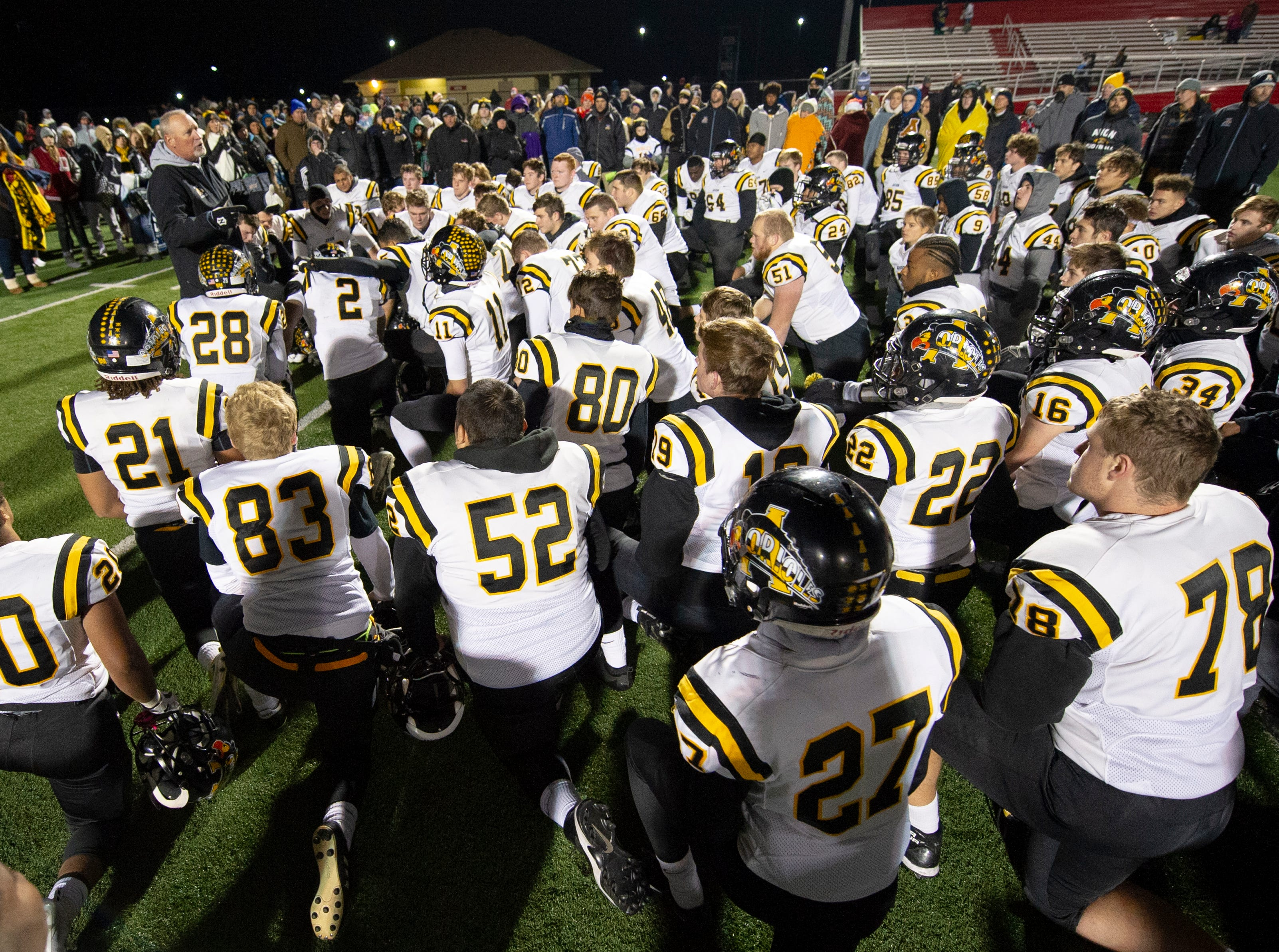The Avon players listen as their coach, Mark Bless, gives them encouragement despite their loss. Center Grove High School hosted Avon High School in an IHSAA Class 6A Regional Championship varsity football game, Friday, Nov. 9, 2018. Center Grove won 17-0 to advance to semi-state.