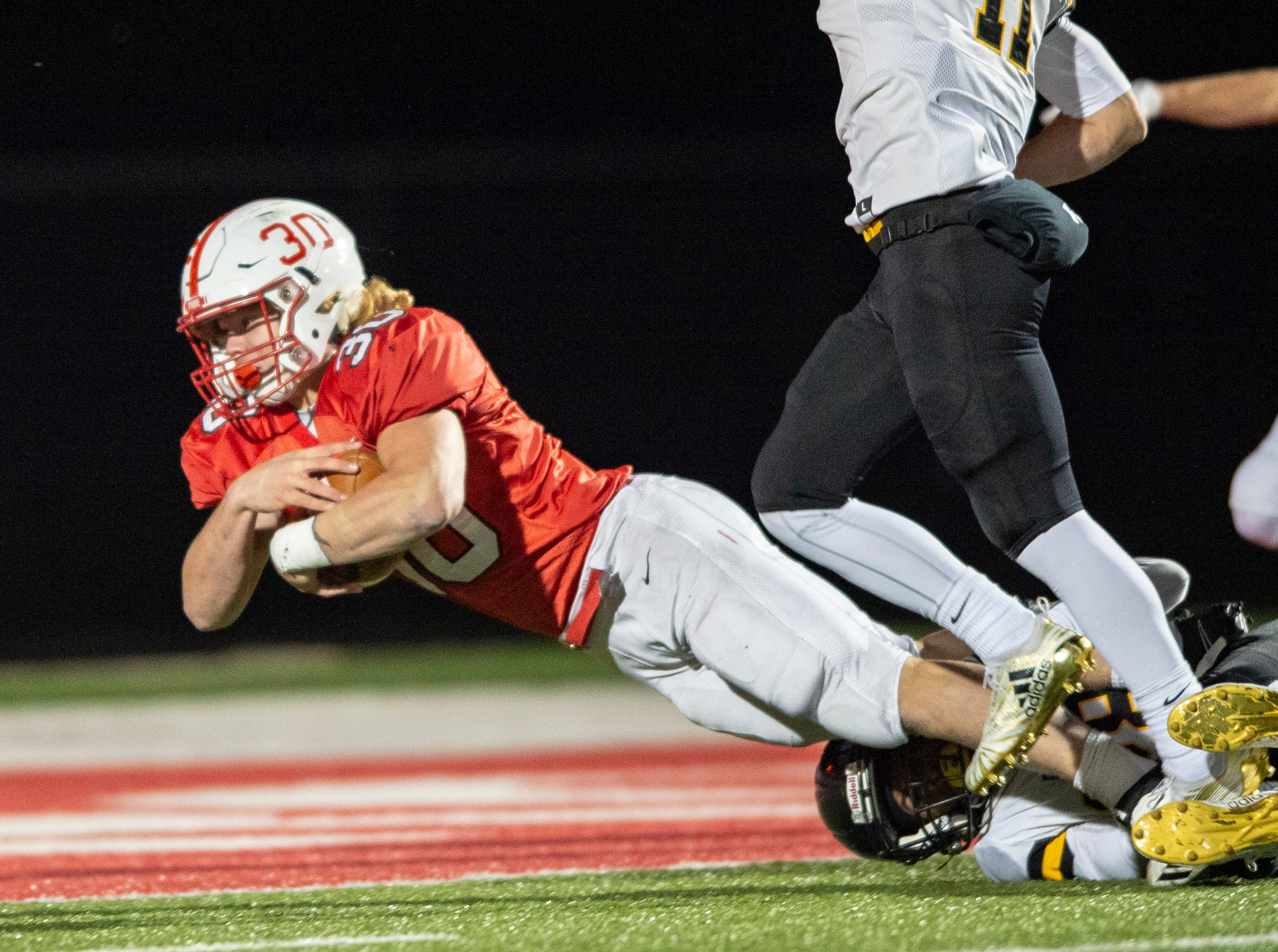 Center Grove High School sophomore Carson Steele (30) makes a diving effort toward the goal line, coming up a yard short, during the first half of action. Center Grove High School hosted Avon High School in an IHSAA Class 6A Regional Championship varsity football game, Friday, Nov. 9, 2018.