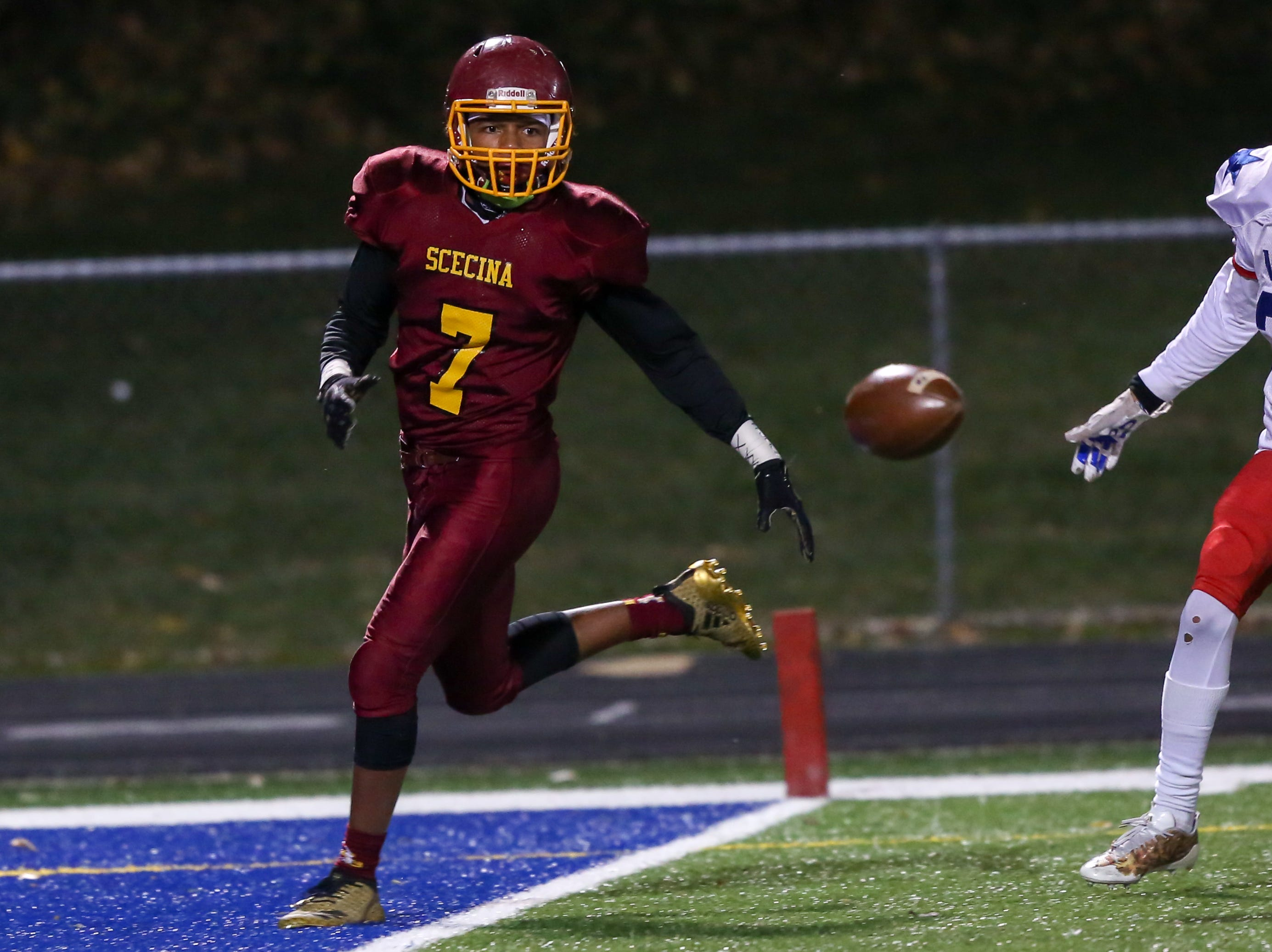 Scecina's Armahn Hillman (7) finds the ball bouncing short on this pass attempt during the first half of Indianapolis Scecina vs Western Boone High School varsity football in the Class 2A Regional Championship held at Roncalli High School, Friday, November 9, 2018.