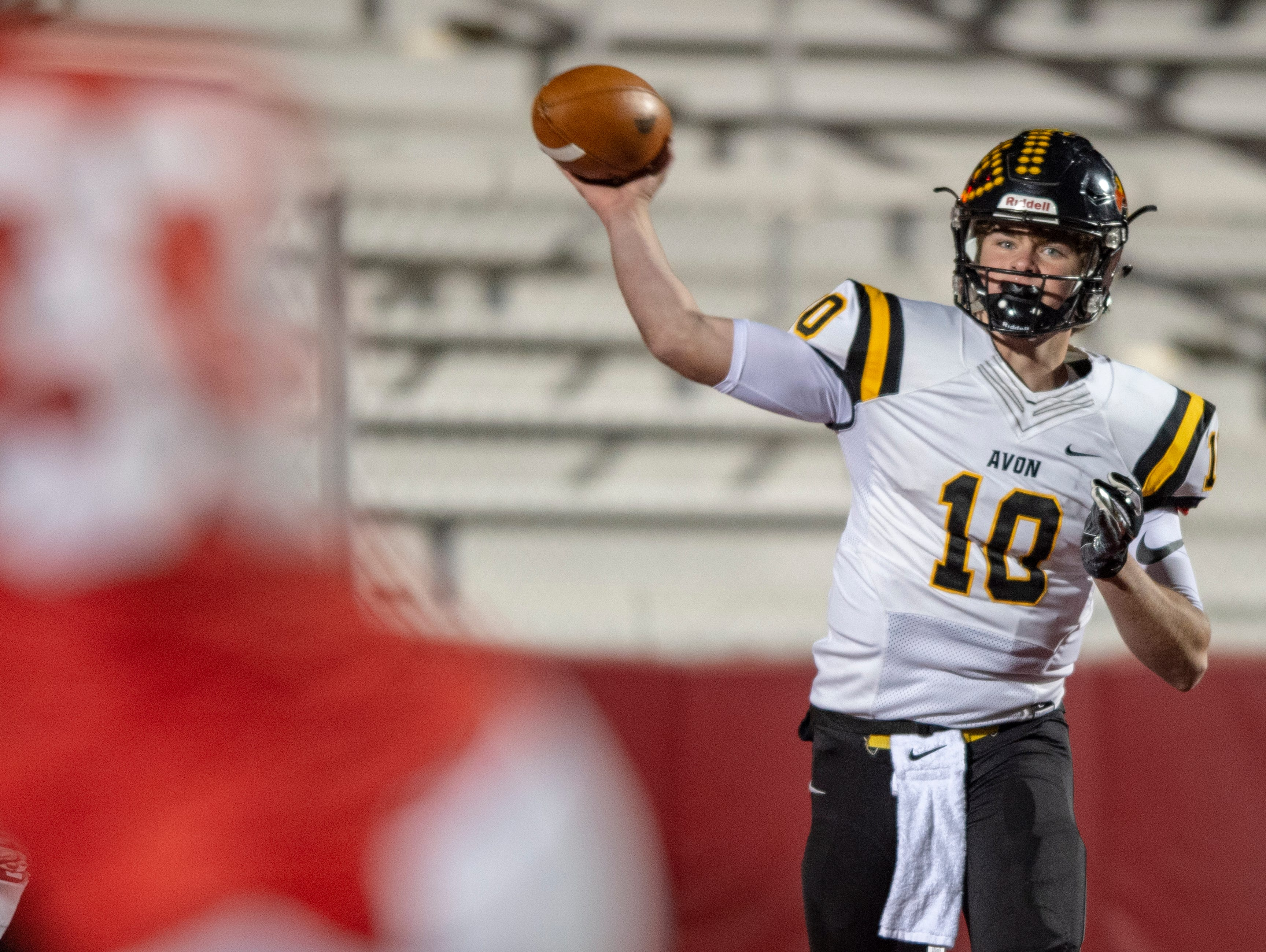 Avon High School sophomore Henry Hesson (10) throws the ball out of the backfield during the first half of action. Center Grove High School hosted Avon High School in an IHSAA Class 6A Regional Championship varsity football game, Friday, Nov. 9, 2018.