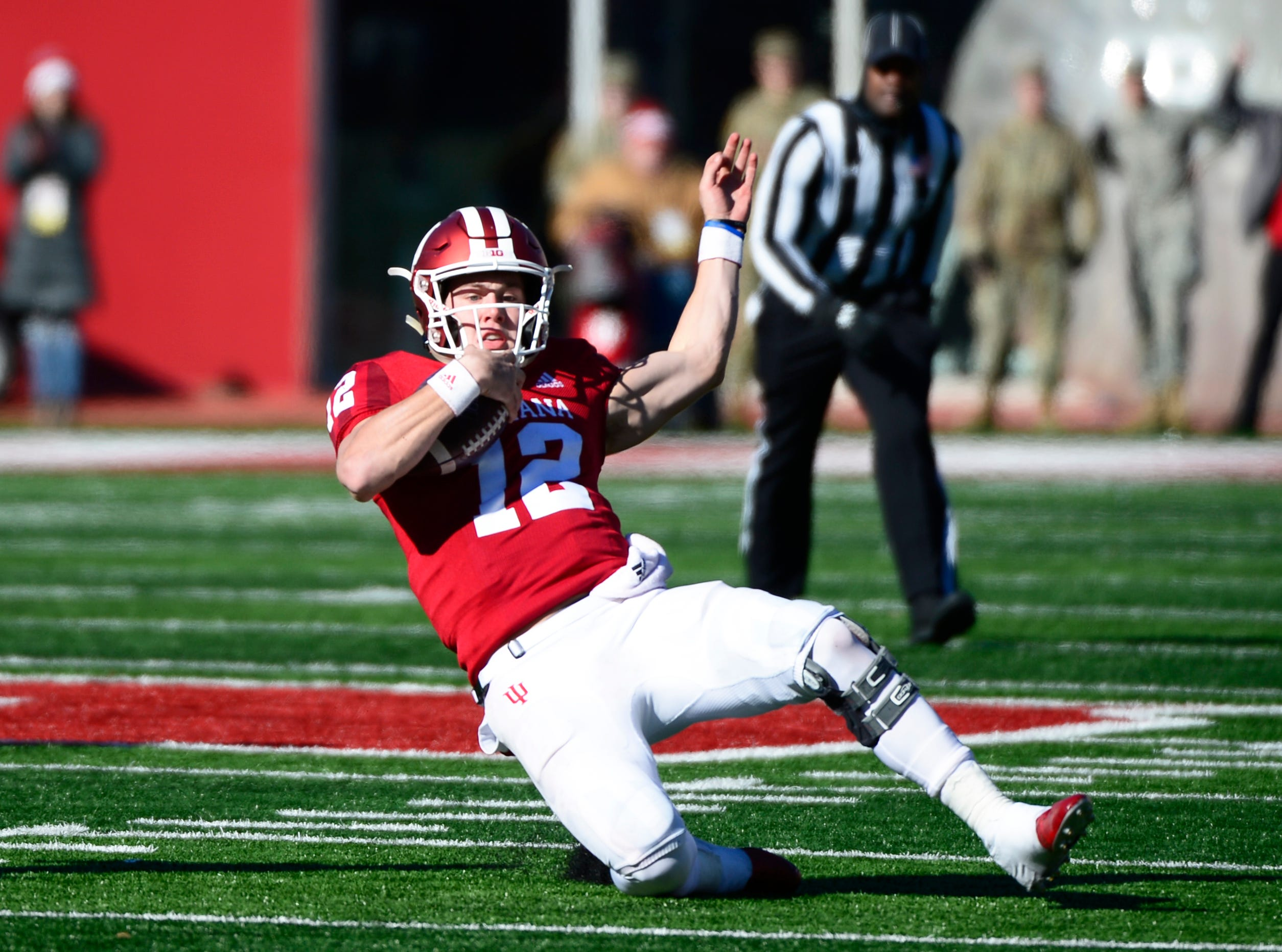 Indiana Hoosiers quarterback Peyton Ramsey (12) slides down during the game against Maryland at Memorial Stadium in Bloomington, Ind., on Satuday, Nov. 10, 2018.