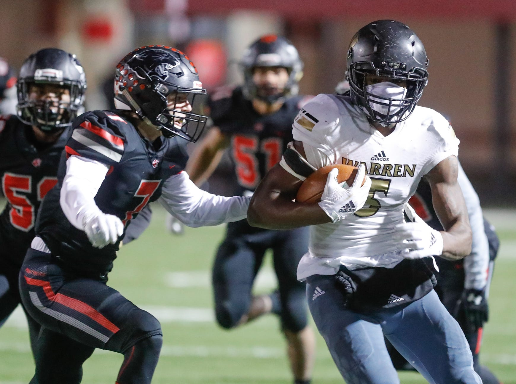 Warren Central High School Warriors tight end Montrez Stanley (5), runs the ball during a regional finals game against the North Central High School Panthers, at North Central High School on Friday, Nov. 9, 2018.