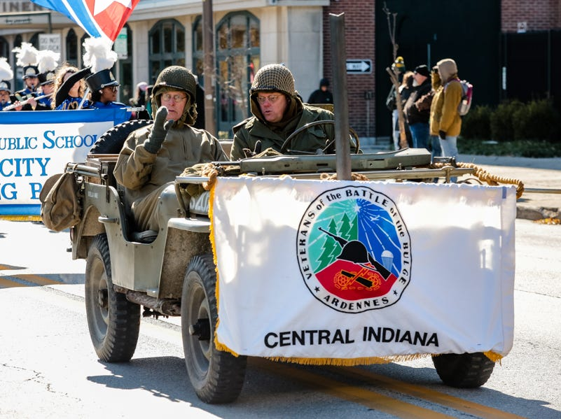 A vehicle drives in the Veterans Day Parade.