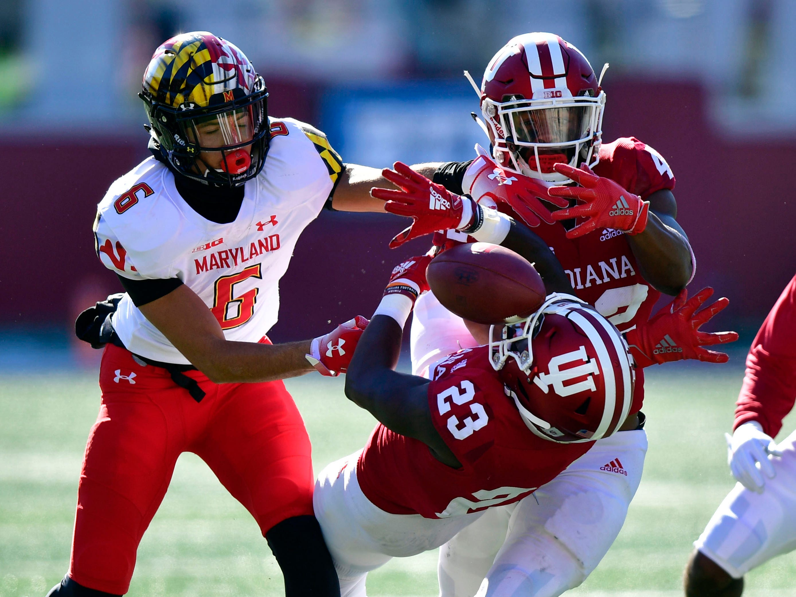 Hoosiers defensive back Jaylin Williams (23) and  Indiana Hoosiers defensive back Marcelino Ball (42) attempt to intercept a ball intended for Maryland Terrapins defensive back Chigozie Onyekwere (6) during the fist half of the the game at Memorial Stadium .