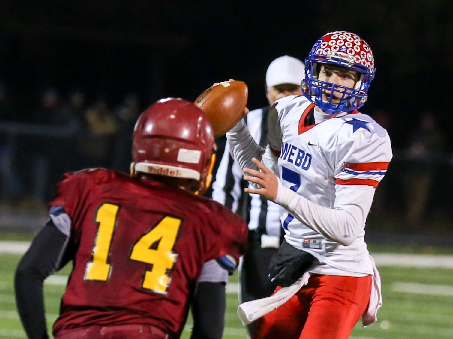 Western Boone's Spencer Wright (7) looks for an open receiver during the first half of Indianapolis Scecina vs Western Boone High School varsity football in the Class 2A Regional Championship held at Roncalli High School, Friday, November 9, 2018.
