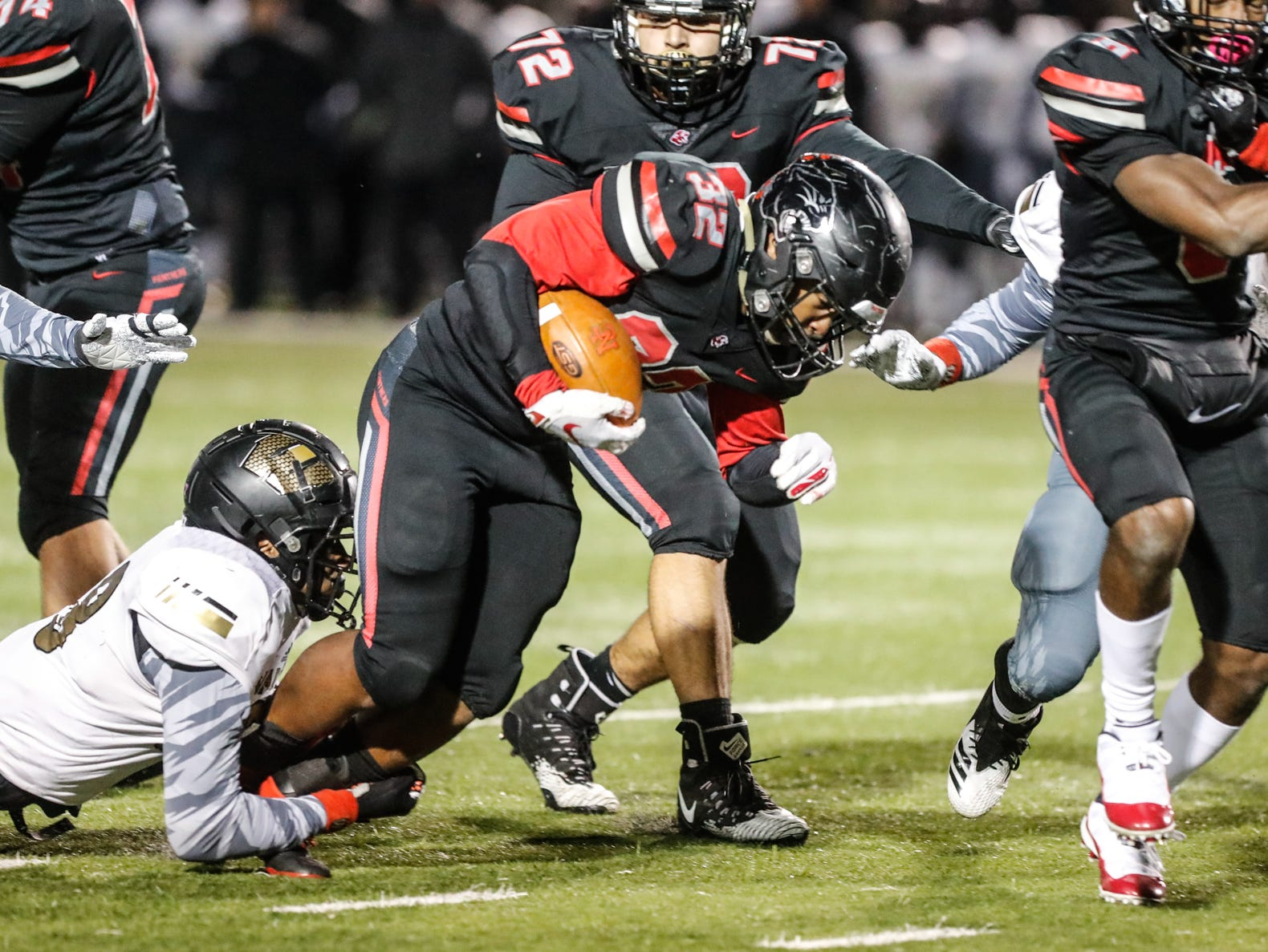 The North Central High School Panthers running back Alexander Tarver (32) is tackled during a regional finals game against the Warren Central High School Warriors at North Central High School on Friday, Nov. 9, 2018.