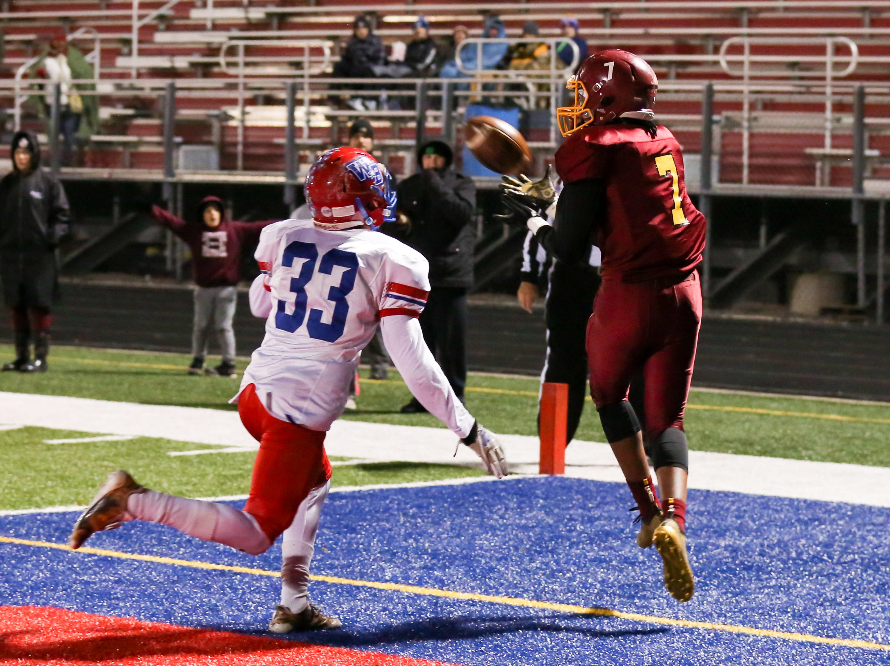 Scecina's Armahn Hillman (7) comes down with a reception and a score during the first half of Indianapolis Scecina vs Western Boone High School varsity football in the Class 2A Regional Championship held at Roncalli High School, Friday, November 9, 2018.