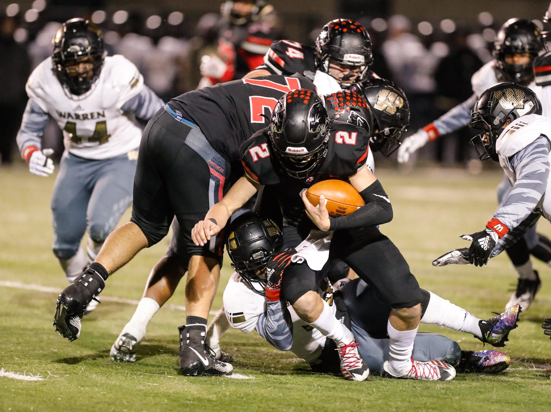 North Central High School Panther's Liam Thompson (2), avoids a tackle during a regional finals game against the Warren Central High School Warriors at North Central High School on Friday, Nov. 9, 2018.
