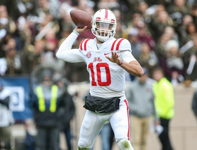 Ole Miss Rebels quarterback Jordan Ta'amu (10) attempts a pass during the first quarter against the Texas A&M Aggies at Kyle Field.