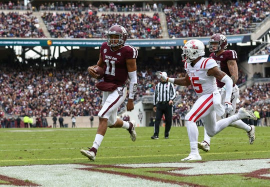 Texas A&M Aggies quarterback Kellen Mond (11) runs with the ball for a touchdown during the first quarter against the Ole Miss Rebels at Kyle Field.