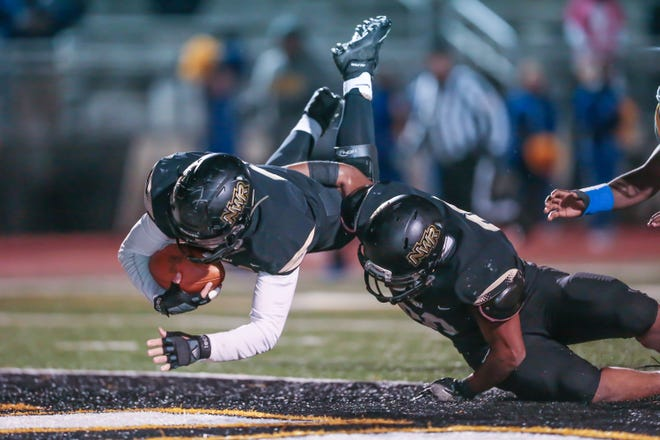 Northwest Rankin's Hayden Hill (21) dives into the end zone for a touchdown after recovering a fumble in the first half Friday at Northwest Rankin