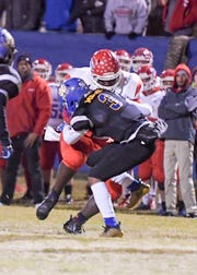 Montgomery's Lakendriez Sanders is stopped by North Side's Nakia Mercer during their playoff game, Friday, November 9. North Side defeated Montgomery Central, 28-26.