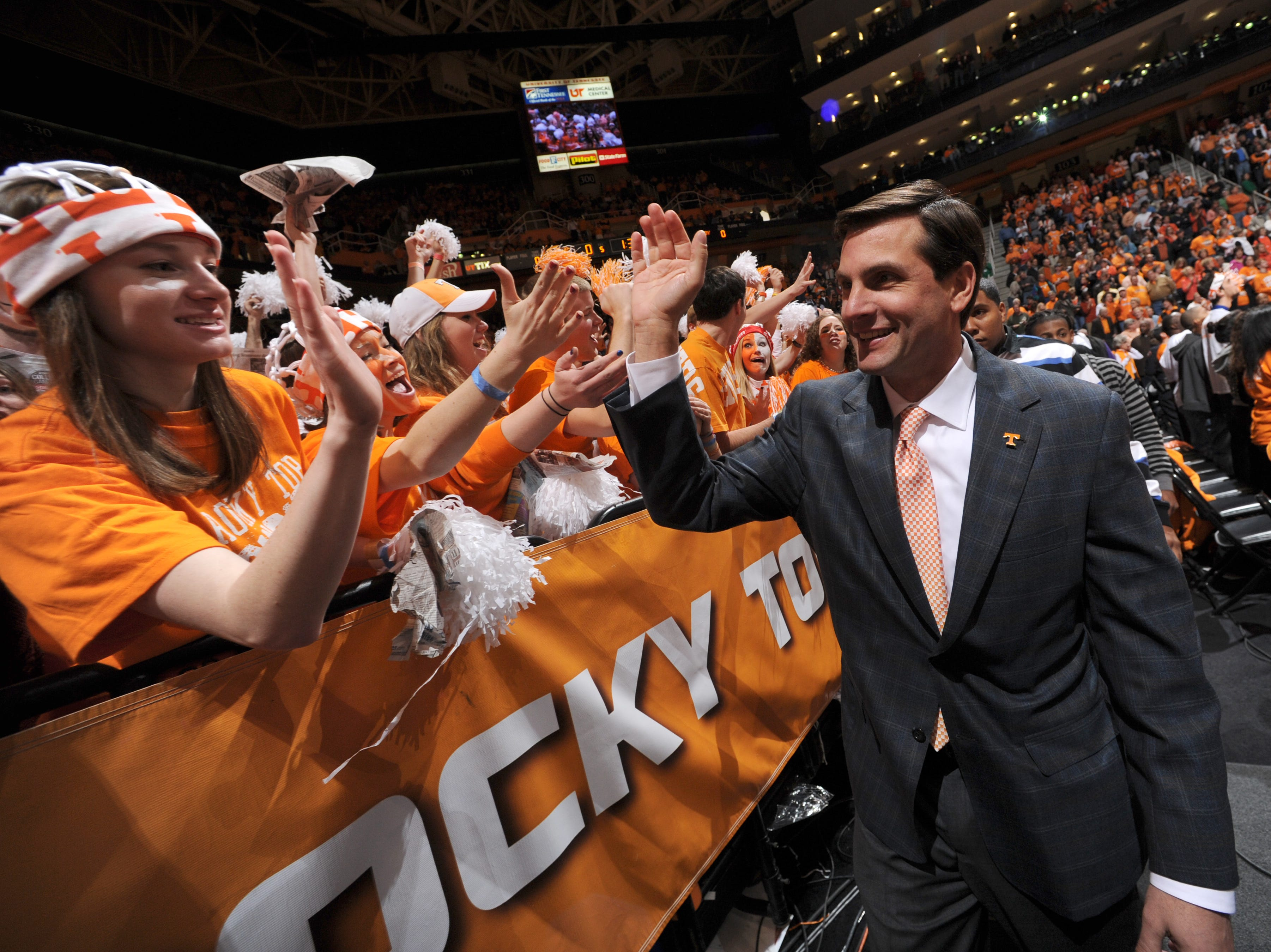 Tennessee football head coach Derek Dooley greets students prior to the Vols' basketball matchup against the Vanderbilt Commodores at Thompson-Boling Arena Saturday, Jan. 15, 2011.
