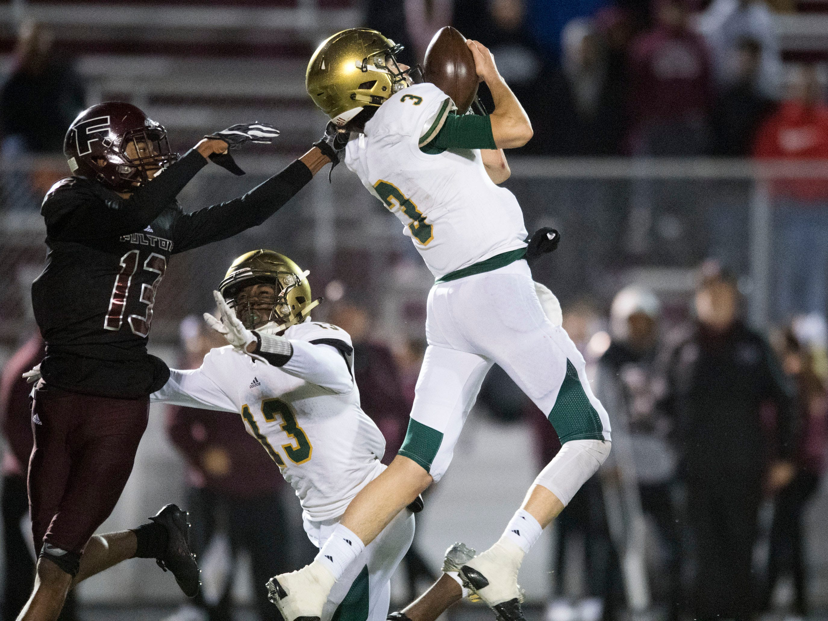Knoxville Catholic's Jack Jancek (3) intercepts a pass intended for Fulton's Amir Johnson (13). Knoxville Catholic beat Fulton, 28-25 in the second round of the Class 5A playoffs on Friday, November 9, 2018.