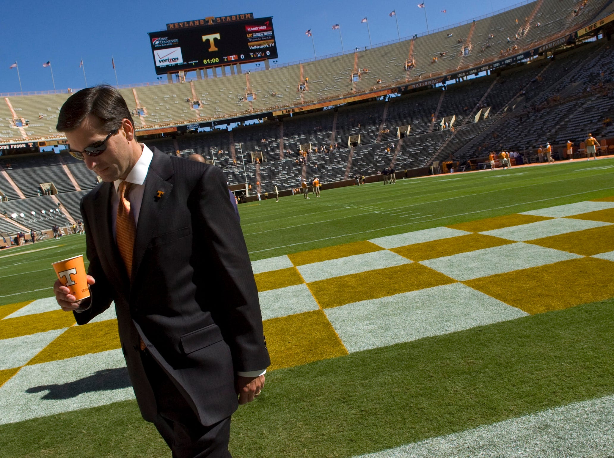 UT head coach Derek Dooley heads to the locker room after checking the field prior to the home opener against UT Martin at Neyland Stadium on Saturday, Sept. 4, 2010. The Vols' season opener was a 50 - 0 victory in Derek Dooley's debut as head coach.