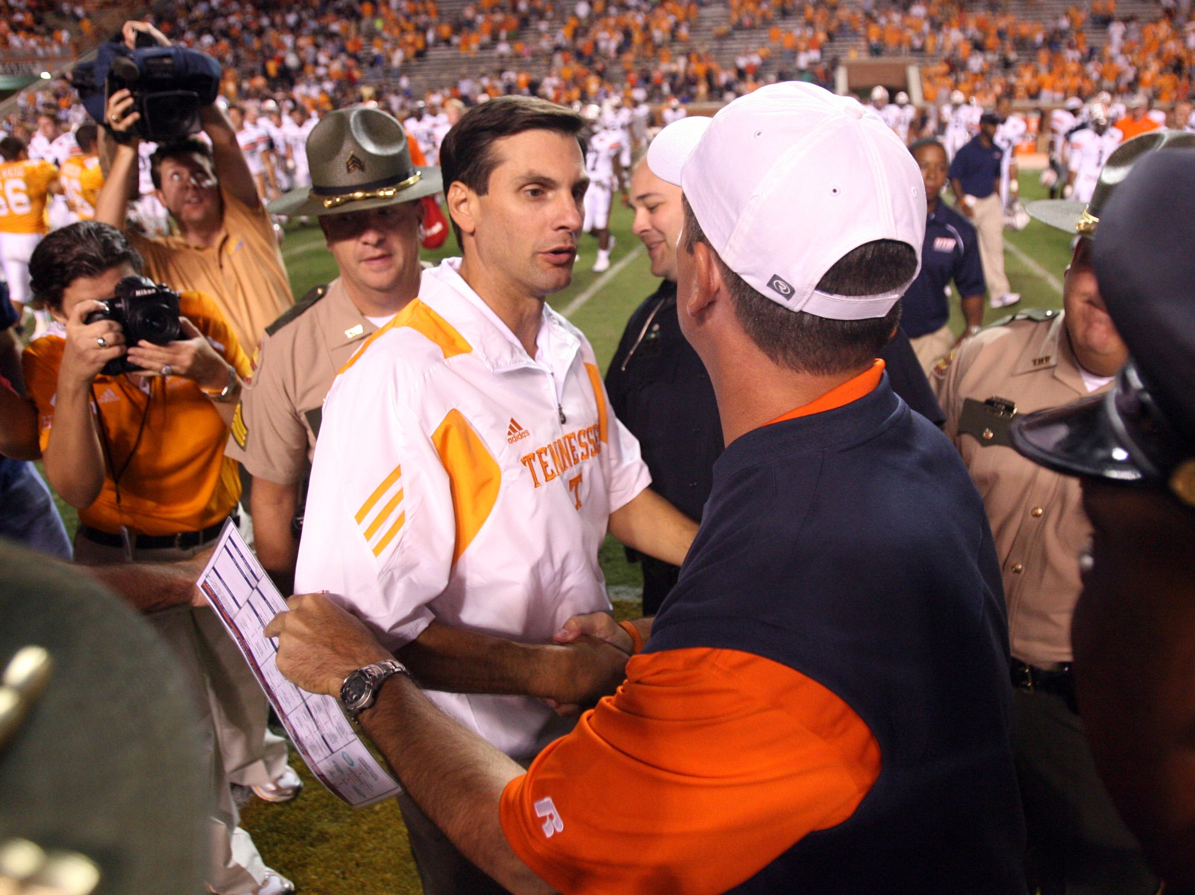 Tennessee head coach Derek Dooley shakes hands with UT Martin head coach Jason Simpson after the Vols defeated the Skyhawks 50-0  at Neyland Stadium Saturday, Sept. 4, 2010. The Vols' season opener was a 50 - 0 victory in Derek Dooley's debut as head coach.