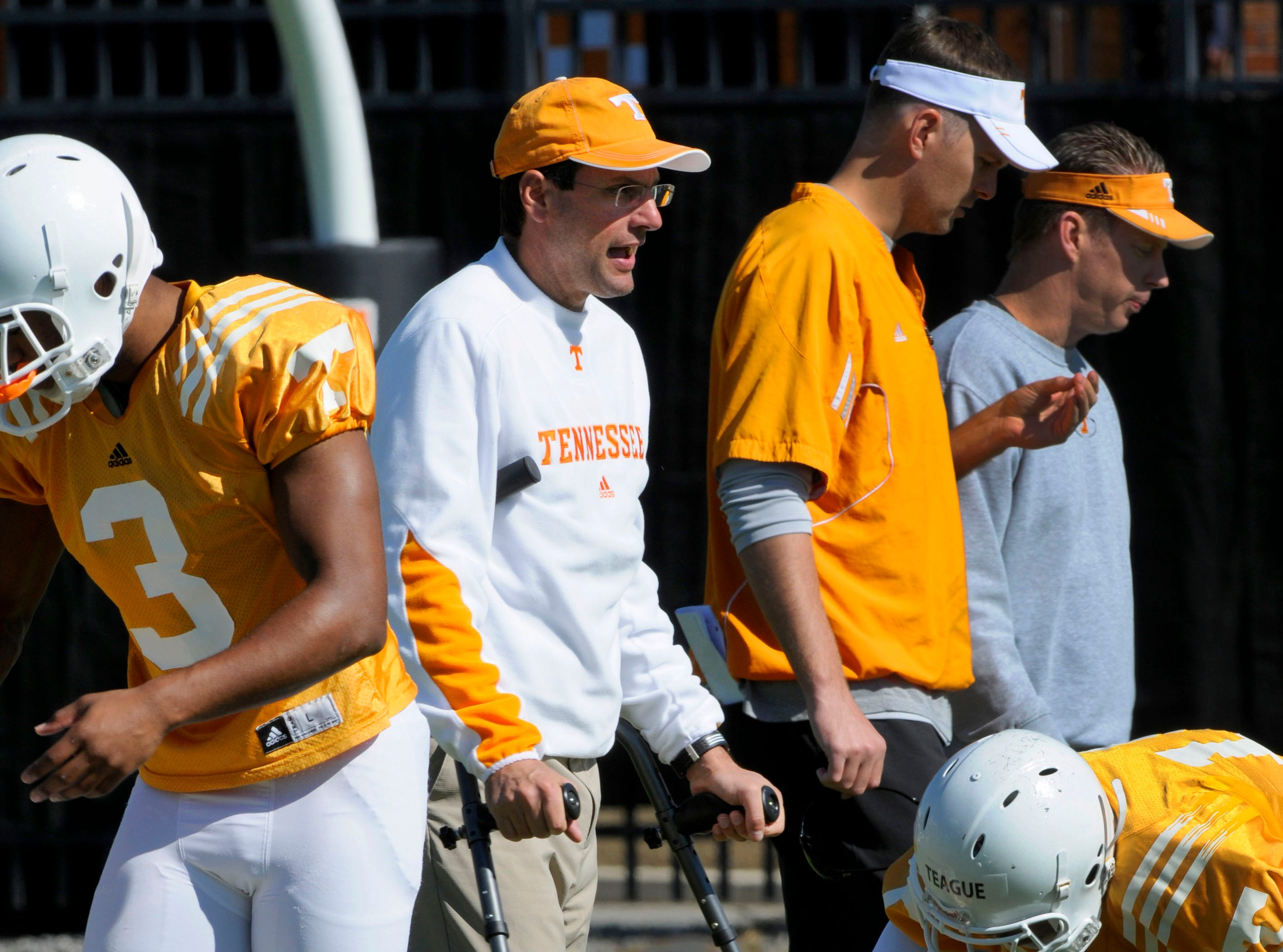 After a short walk on his crutches away from the media position Tennessee head coach Derek Dooley returned to his golf cart at practice Thursday, Oct. 11, 2012.