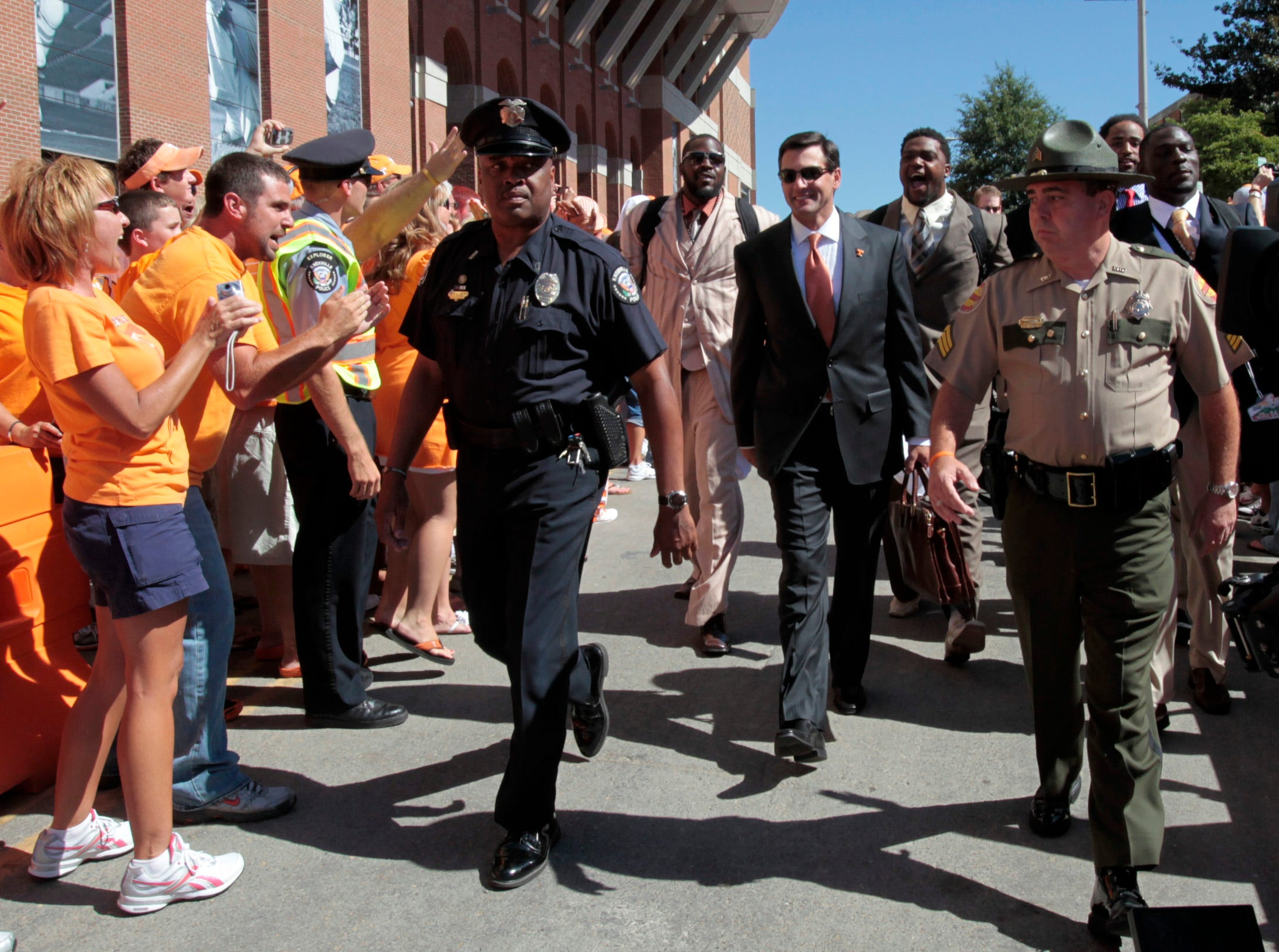 Tennessee coach Derek Dooley, center, participates in his first Vol Walk before the UT Martin game Saturday, Sept. 4, 2010 at Neyland Stadium. The Vols' season opener was a 50 - 0 victory in Derek Dooley's debut as head coach.
