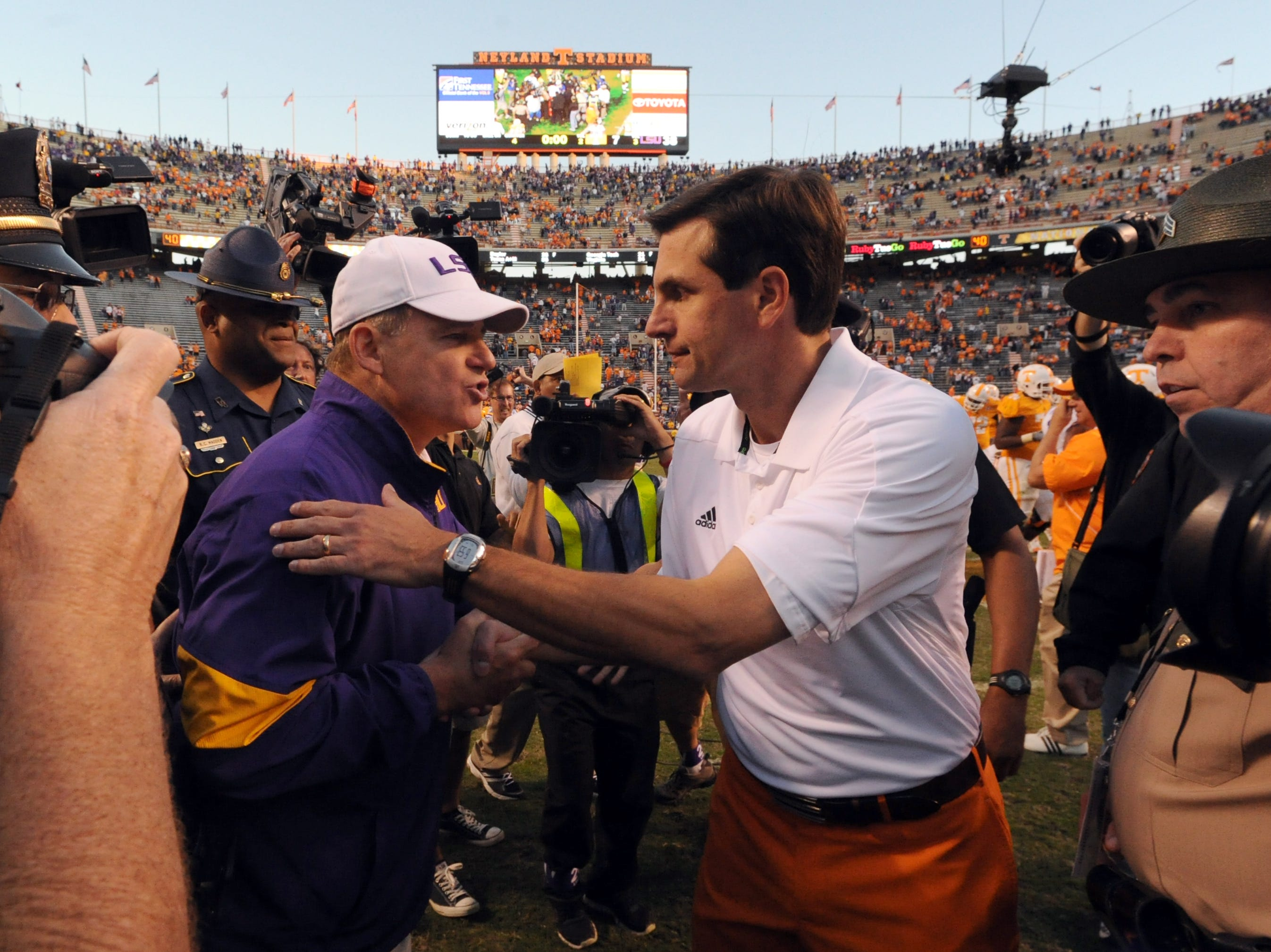 Tennessee head coach Derek Dooley, right, shakes hands with LSU head coach Les Miles after the Vols loss to the Tigers at Neyland Stadium Saturday, Oct. 15, 2011.  LSU won the game 38-7 over Tennessee.