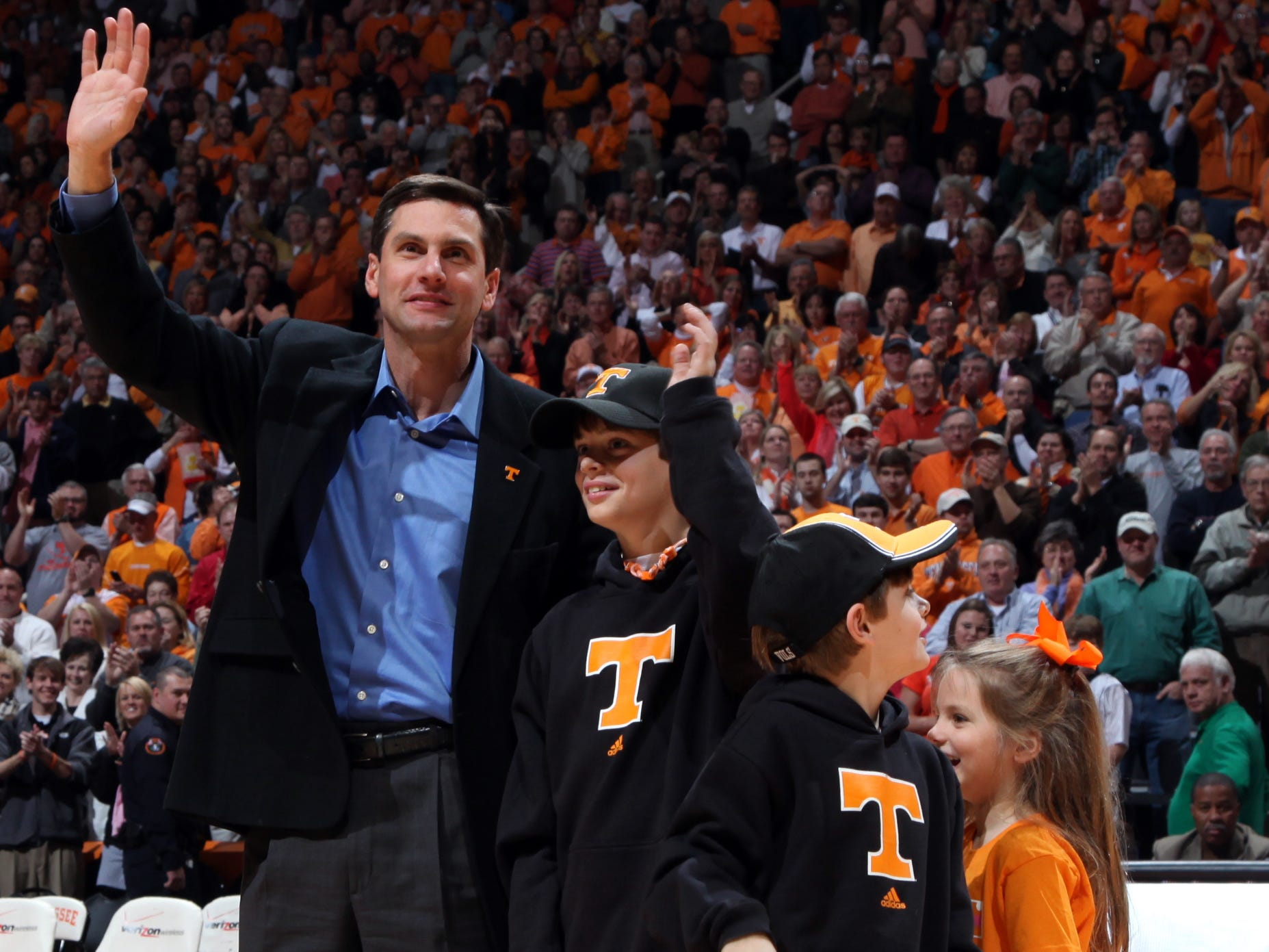 Tennessee football head coach Derek Dooley is introduced along with his children John Taylor, Peyton and Juliana during the Vols' matchup against the Ole Miss Rebels at Thompson-Boling Arena Saturday, Jan. 16, 2010.