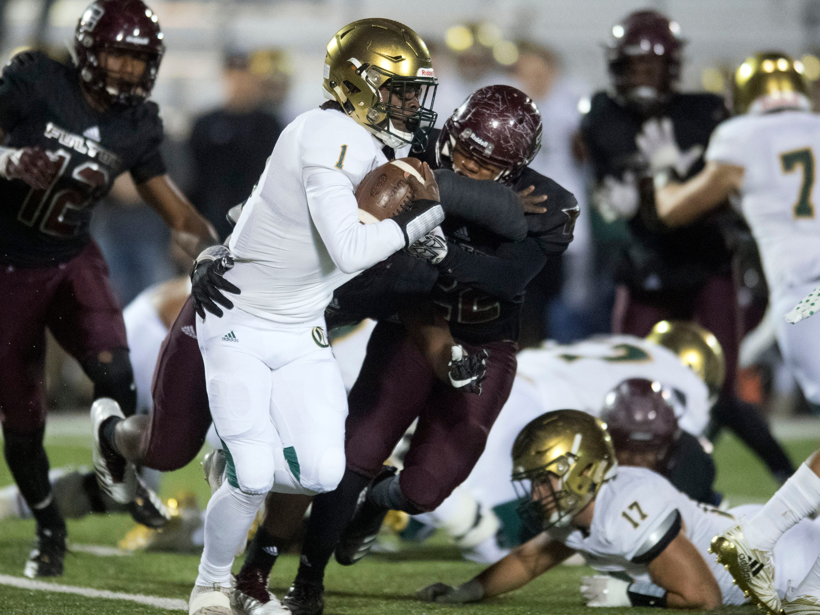 Knoxville Catholic's Keondre' Jarmon (1) is grabbed by Fulton's Terrence Brown (22). Knoxville Catholic beat Fulton, 28-25 in the second round of the Class 5A playoffs on Friday, November 9, 2018.