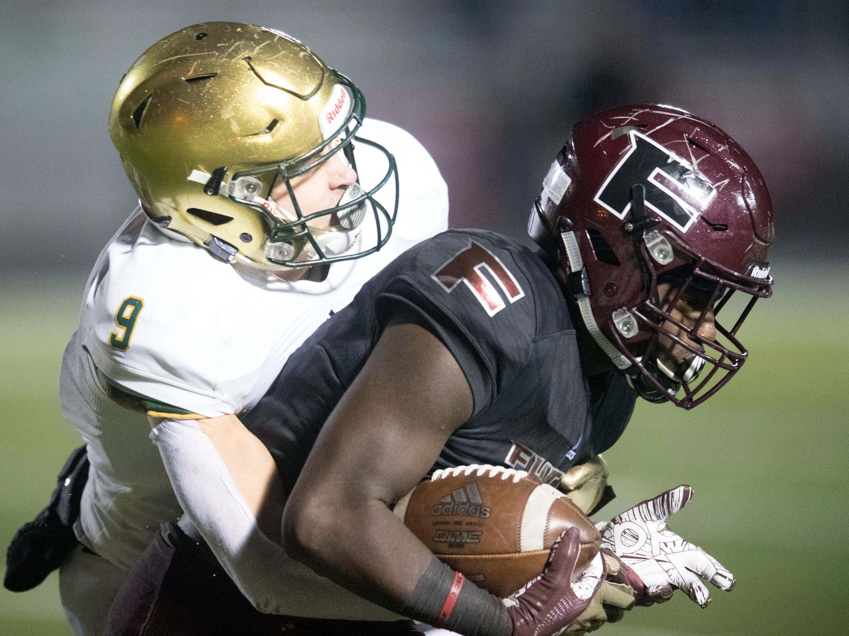 Fulton's JaShaun Fenderson (2) is tackled by Knoxville Catholic's Adam Jones (9). Knoxville Catholic beat Fulton, 28-25 in the second round of the Class 5A playoffs on Friday, November 9, 2018.